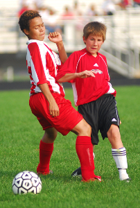 Stanton Junior High soccer player Josh Hupper (right) elbows a Memorial Middle School opponent during the second half of a game at Theodore Roosevelt High School in Kent, Ohio on Sept. 11, 2006.